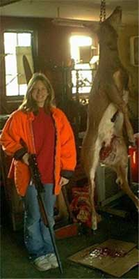 "This is 13 yr old Katie Schroeder's first deer. Opening morning of the 2001 gun deer season in Southern Wisconsin. Opening Morning We sat in our duel permanent tree stand. Katie sat patient watching the trail she had seen several deer on during early bow season. We were only in our stand for an hour or so when She nudged my arm letting me know she had seen something. I couldn't turn around until she was standing. She lifted her Remington 20 gauge as if she was a well seasoned hunter. Then I heard her whisper ""can I shoot it""? ""It's your call"" I whispered back.  She shot and watched as the doe stumbled into the brush. ""I hit it. I hit it""! she said with the biggest smile. ""I hit it in the shoulder just like I am supposed to"".  
