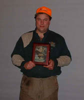 Jeff Olson taking 4th in the Top Gun Flusher Division at the 18th Annual US Open Pheasant Championship with Doc a six year old black 