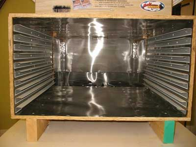 The other half is the dehydrator box with supports for ten drying racks. It is also lined with metal.